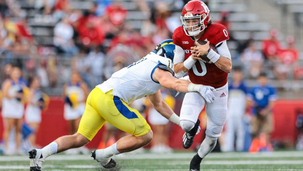 Sep 18, 2021; Piscataway, New Jersey, USA; Rutgers Scarlet Knights quarterback Noah Vedral (0) breaks a tackle by Delaware Fightin Blue Hens linebacker Liam Trainer (11) during the second half at SHI Stadium. Mandatory Credit: Vincent Carchietta-USA TODAY Sports