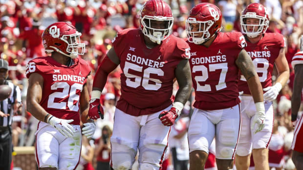Sep 18, 2021; Norman, Oklahoma, USA; Oklahoma Sooners running back Kennedy Brooks (26) celebrates with  offensive lineman Chris Murray (56) and tight end Jeremiah Hall (27) after scoring a touchdown during the fourth quarter against the Nebraska Cornhuskers at Gaylord Family-Oklahoma Memorial Stadium. Mandatory Credit: Kevin Jairaj-USA TODAY Sports