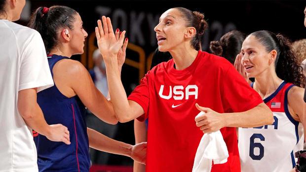 Aug 6, 2021; Saitama, Japan; Team United States guard Diana Taurasi (12) greets Serbia after their game in the women's basketball semi-final during the Tokyo 2020 Olympic Summer Games at Saitama Super Arena.