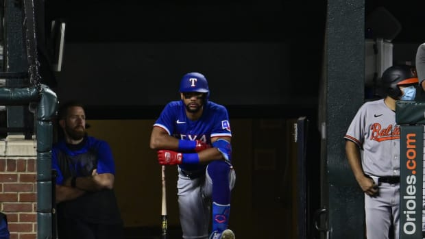 Sep 23, 2021; Baltimore, Maryland, USA; Texas Rangers center fielder Leody Taveras (3) looks onto the field from the dugout while awaiting a fifth inning at bat against the Baltimore Orioles at Oriole Park at Camden Yards. Mandatory Credit: Tommy Gilligan-USA TODAY Sports