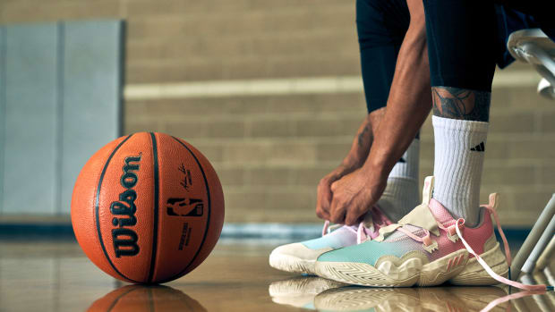 Trae Young lacing up the ICEE Cotton Candy colorway of the Adidas Trae Young 1