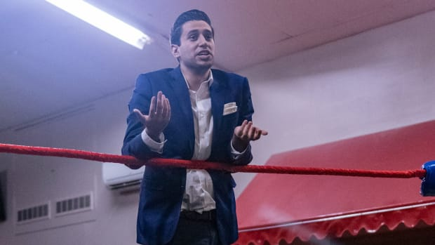 David Alba in the ring wearing a suit at a Limitless Wrestling show