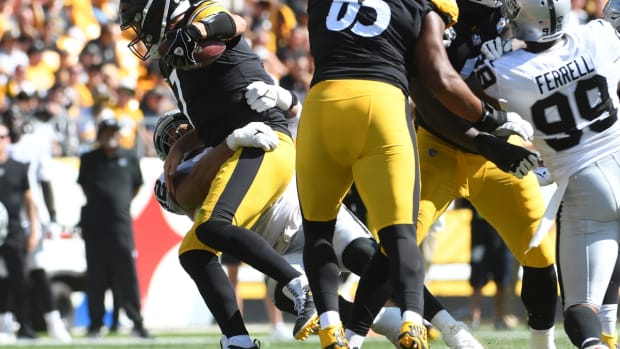 Sep 19, 2021; Pittsburgh, Pennsylvania, USA; Pittsburgh Steelers quarterback Ben roethlisberger is sacked by Las Vegas Raiders defensive tackle Solomon Thomas during the fourth quarter at Heinz Field. The Raiders won the game 26-17. Mandatory Credit: Philip G. Pavely-USA TODAY Sports