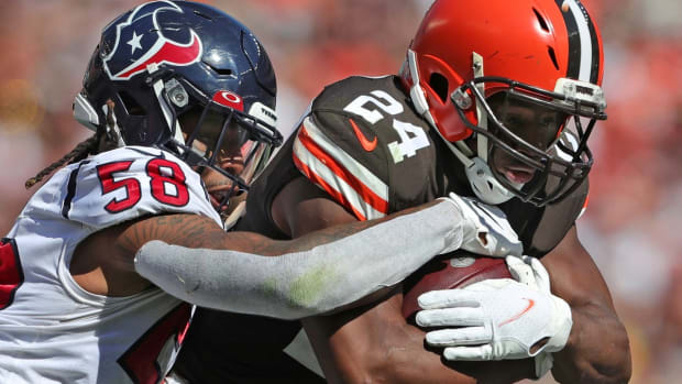 Cleveland Browns running back Nick Chubb (24) rushes for a short gain against Houston Texans outside linebacker Christian Kirksey (58) during the second half of an NFL football game, Sunday, Sept. 19, 2021, in Cleveland, Ohio. [Jeff Lange/Beacon Journal]  Browns 12