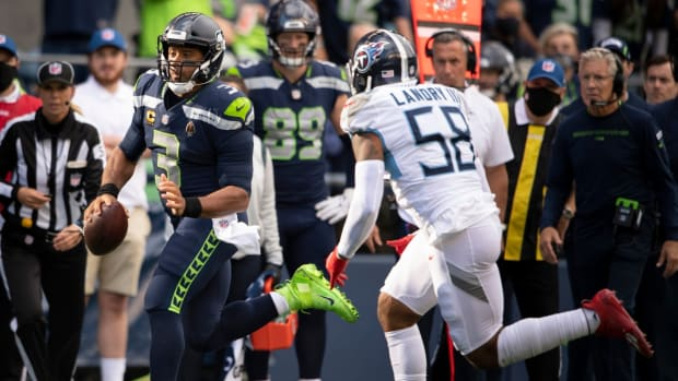 Seattle Seahawks quarterback Russell Wilson (3) rushes past Tennessee Titans linebacker Harold Landry (58) during the second half at Lumen Field Sunday, Sept. 19, 2021 in Seattle, Wash.  Nas Titans Seahawks 026