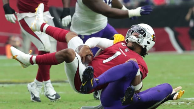Arizona Cardinals quarterback Kyler Murray (1) is tackled by Minnesota Vikings defensive end Danielle Hunter (99) during the fourth quarter in Glendale, Ariz. Sept. 19, 2021.  Cardinals Vs Vikings