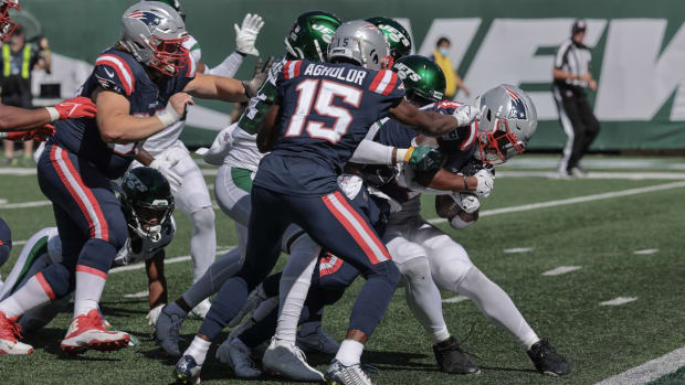 Sep 19, 2021; East Rutherford, New Jersey, USA; New England Patriots running back Damien Harris (37) scores a rushing touchdown during the second half against the New York Jets at MetLife Stadium. Mandatory Credit: Vincent Carchietta-USA TODAY Sports