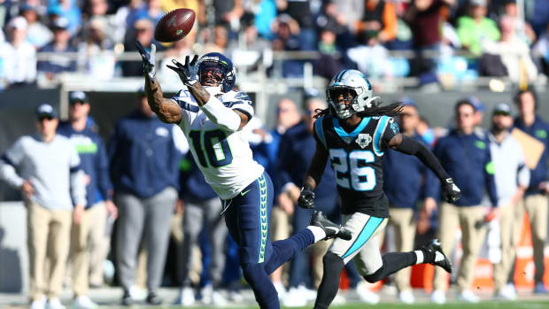 Dec 15, 2019; Charlotte, NC, USA; Seattle Seahawks wide receiver Josh Gordon (10) catches a pass against Carolina Panthers cornerback Donte Jackson (26) during the second quarter at Bank of America Stadium.