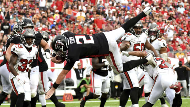Sep 19, 2021; Tampa, Florida, USA; Atlanta Falcons quarterback Matt Ryan (2) leaps to score a two point conversion in the second half against the Tampa Bay Buccaneers at Raymond James Stadium.