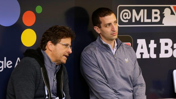 Milwaukee Brewers general manager David Stearns, right, talks with Brewers principal owner Mark Attanasio before a game last season.