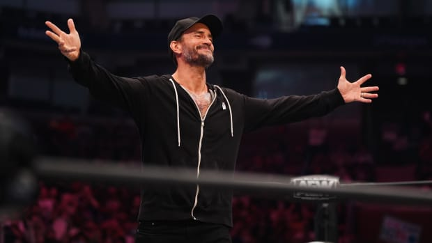 AEW's CM Punk greets the crowd before a promo