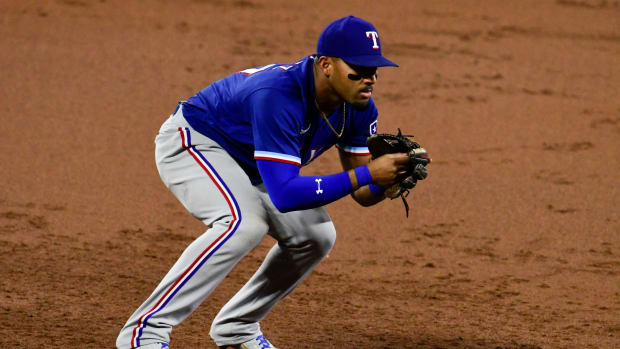 Sep 23, 2021; Baltimore, Maryland, USA; Texas Rangers third baseman Andy Ibanez (77) looks towards the plate during the game against the Baltimore Orioles at Oriole Park at Camden Yards. Mandatory Credit: Tommy Gilligan-USA TODAY Sports