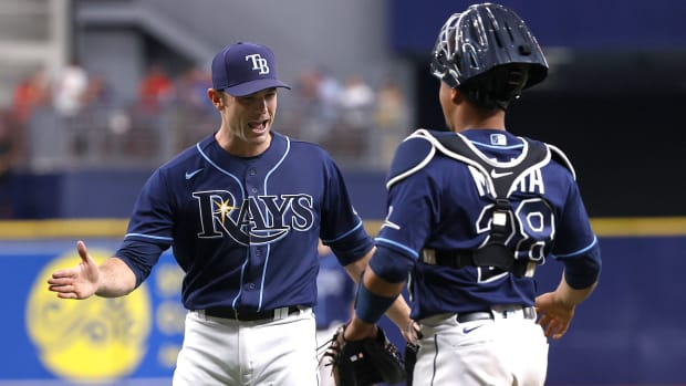 Sep 22, 2021; St. Petersburg, Florida, USA; Tampa Bay Rays relief pitcher David Robertson (30) and Tampa Bay Rays catcher Francisco Mejia (28) celebrate as they beat the Toronto Blue Jays to clinch a playoff spot at Tropicana Field.