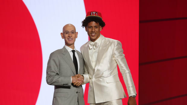 Jalen Johnson (Duke) poses with NBA commissioner Adam Silver after being selected as the number twenty overall pick by the Atlanta Hawks in the first round of the 2021 NBA Draft at Barclays Center.