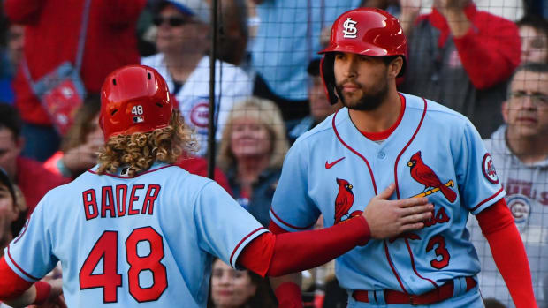 St. Louis Cardinals center fielder Harrison Bader (48) celebrates with St. Louis Cardinals left fielder Dylan Carlson (3) after scoring during the seventh inning against the Chicago Cubs