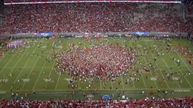 Fans rushing the field after NC State upset Clemson.
