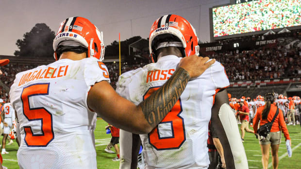 Justyn Ross is consoled by QB D.J. Uiagalelei after Clemson's loss to NC State