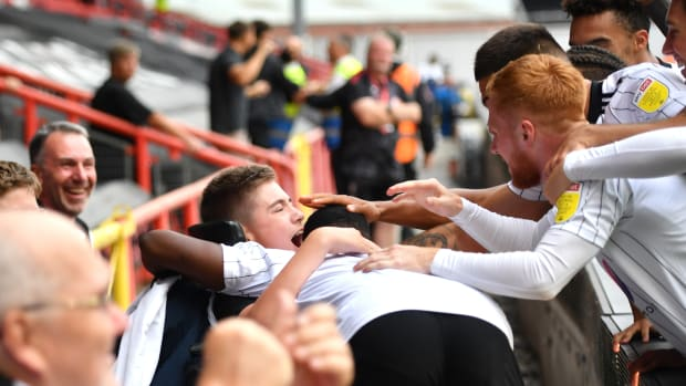 Fulham celebrates with 13-year-old fan Rhys Porter.