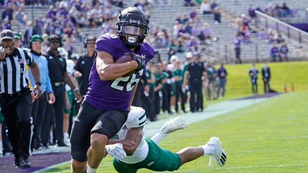 Northwestern Wildcats running back Evan Hull (26) runs the ball for a touchdown as Ohio Bobcats cornerback John Gregory (13) pursues him during the first half at Ryan Field. David Banks-USA TODAY Sports