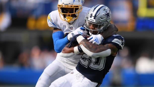 Sep 19, 2021; Inglewood, California, USA; Dallas Cowboys running back Tony Pollard (20) is tackled by Los Angeles Chargers cornerback Michael Davis (43) during the second half at SoFi Stadium. Mandatory Credit: Orlando Ramirez-USA TODAY Sports