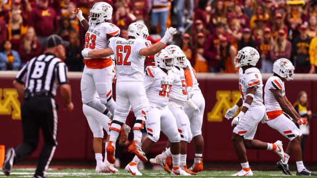Sep 25, 2021; Minneapolis, Minnesota, USA; Bowling Green Falcons defensive lineman Billie Roberts (93) and Bowling Green Falcons guard Malone VanGorder (62) celebrate after a play during the second quarter against the Minnesota Gophers at Huntington Bank Stadium.
