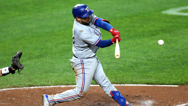 Sept. 25, 2021; Baltimore, Maryland, USA; Texas Rangers catcher Jose Trevino (23) hits a home run against the Baltimore Orioles during the eighth inning at Oriole Park at Camden Yards. Mandatory Credit: Daniel Kucin Jr.-USA TODAY Sports
