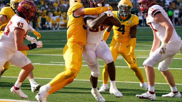 ep 25, 2021; Waco, Texas, USA; Iowa State Cyclones running back Breece Hall (28) runs in to the end zone as Baylor Bears linebacker Matt Jones (52) attempts to make the tackle in the second half at McLane Stadium.