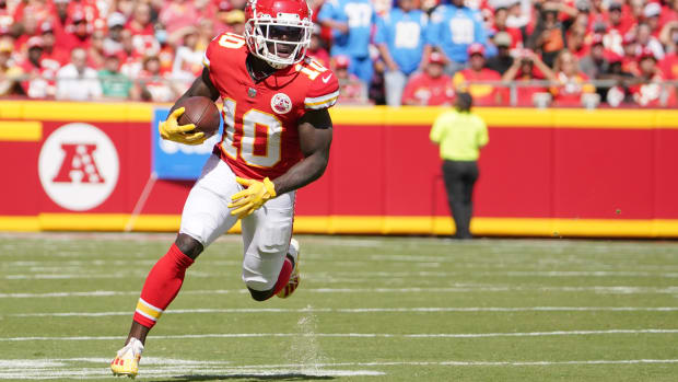 Sep 26, 2021; Kansas City, Missouri, USA; Kansas City Chiefs wide receiver Tyreek Hill (10) runs the ball against the Los Angeles Chargers during the first half at GEHA Field at Arrowhead Stadium. Mandatory Credit: Denny Medley-USA TODAY Sports