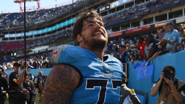 Tennessee Titans offensive tackle Taylor Lewan (77) celebrates as he leaves the field after a win against the Indianapolis Colts at Nissan Stadium.