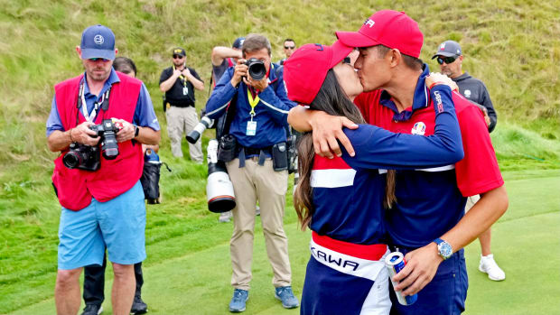 Collin Morikawa kisses girlfriend Katherine Zhu after the Ryder up win