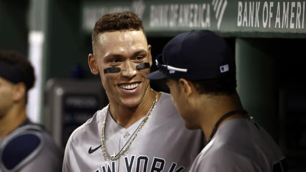 Yankees RF Aaron Judge smiling in dugout