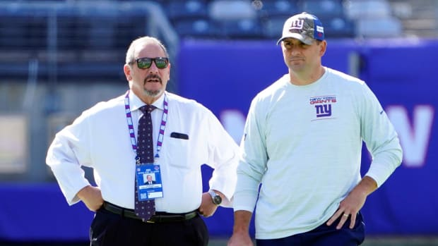 New York Giants general manager Dave Gettleman, left, and head coach Joe Judge talk on the field before the game at MetLife Stadium on Sunday, Sept. 26, 2021, in East Rutherford.