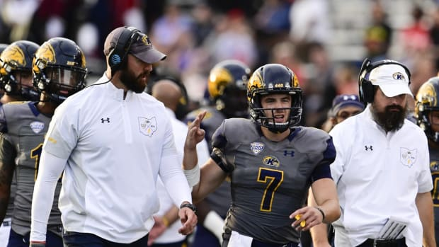 Sep 25, 2021; College Park, Maryland, USA; Kent State Golden Flashes head coach Sean Lewis speaks with quarterback Dustin Crum (7) on the sidelines during the fourth quarter against the Maryland Terrapins at Capital One Field at Maryland Stadium. Mandatory Credit: Tommy Gilligan-USA TODAY Sports