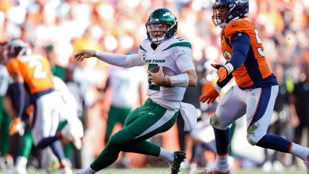 Jets QB Zach Wilson scrambles against Denver Broncos
