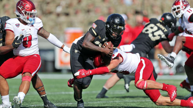 Sep 25, 2021; West Point, New York, USA; Army Black Knights quarterback Tyhier Tyler (2) runs with the ball against the Miami (Ohio) RedHawks during the second half at Michie Stadium. Mandatory Credit: Danny Wild-USA TODAY Sports