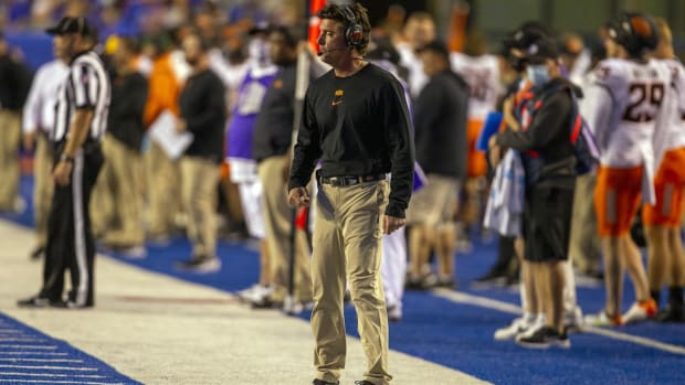 Sep 18, 2021; Boise, Idaho, USA; Oklahoma State Cowboys head coach Mike Gundy looks on during the first half against the Boise State Broncos at Albertsons Stadium. Mandatory Credit: Brian Losness-USA TODAY Sports