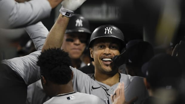 Yankees Giancarlo Stanton and Aaron Judge celebrate in dugout