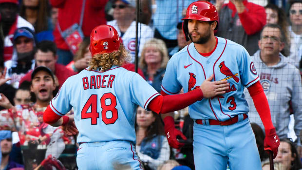 Sep 25, 2021; Chicago, Illinois, USA; St. Louis Cardinals center fielder Harrison Bader (48) celebrates with St. Louis Cardinals left fielder Dylan Carlson (3) after scoring during the seventh inning against the Chicago Cubs at Wrigley Field.