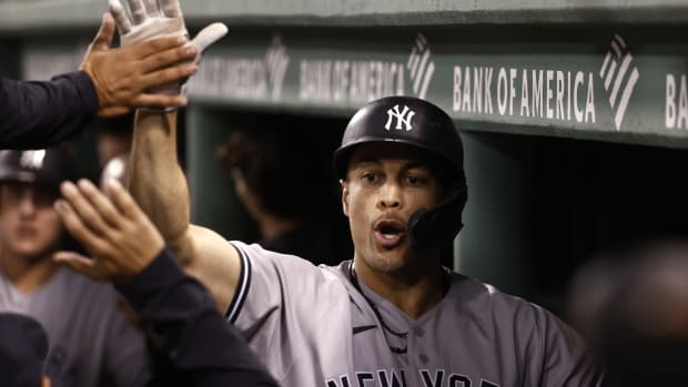 Yankees DH Giancarlo Stanton high fives in dugout