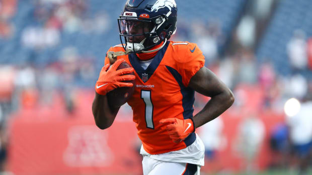 Denver Broncos wide receiver K.J. Hamler (1) warms up before the game against the Los Angeles Rams at Empower Field at Mile High.