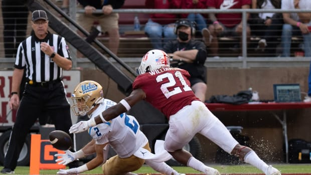 Sep 25, 2021; Stanford, California, USA; UCLA Bruins wide receiver Kyle Philips (2) catches the ball for a touchdown during the fourth quarter against Stanford Cardinal safety Kendall Williamson (21) at Stanford Stadium. Mandatory Credit: Stan Szeto-USA TODAY Sports