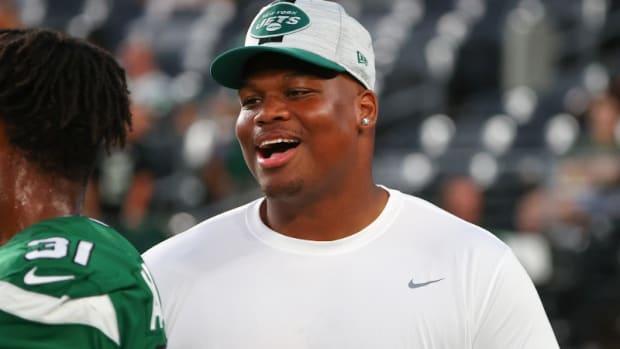 Jets defensive lineman Quinnen Williams smiling