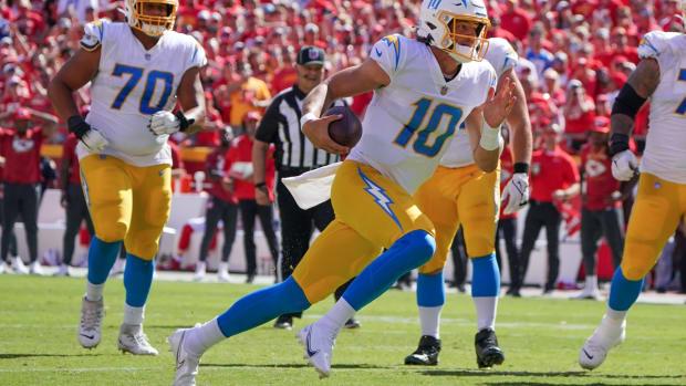 Sep 26, 2021; Kansas City, Missouri, USA; Los Angeles Chargers quarterback Justin Herbert (10) runs the ball against the Kansas City Chiefs during the second half at GEHA Field at Arrowhead Stadium. Mandatory Credit: Denny Medley-USA TODAY Sports
