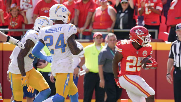 Sep 26, 2021; Kansas City, Missouri, USA; Kansas City Chiefs running back Clyde Edwards-Helaire (25) runs in for a touchdown against the Los Angeles Chargers during the second half at GEHA Field at Arrowhead Stadium. Mandatory Credit: Denny Medley-USA TODAY Sports