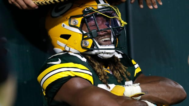 A fan places a sombrero on Green Bay Packers running back Aaron Jones (33) after he scored a touchdown against the Detroit Lions during their football game Monday, September 20, 2021, at Lambeau Field in Green Bay, Wis. Dan Powers/USA TODAY NETWORK-Wisconsin  Apc Packvsdetroit 0920212226djp