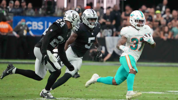 Sep 26, 2021; Paradise, Nevada, USA; Miami Dolphins running back Myles Gaskin (37) is pursued by Las Vegas Raiders defensive back Johnathan Abram (24) and linebacker Divine Deablo (5) in overtime at Allegiant Stadium.The Raiders defeated the Dolphins 31-28 in overtime. Mandatory Credit: Kirby Lee-USA TODAY Sports