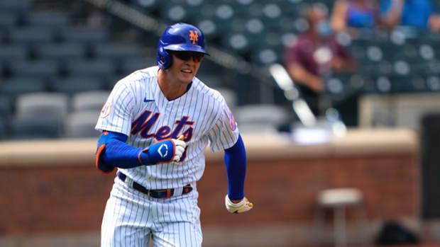 Aug 31, 2021; New York City, New York, USA; New York Mets center fielder Brandon Nimmo (9) runs out a double during the first inning against the Miami Marlins at Citi Field.