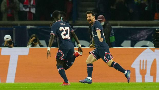Lionel Messi celebrates with Idrissa Gueye.