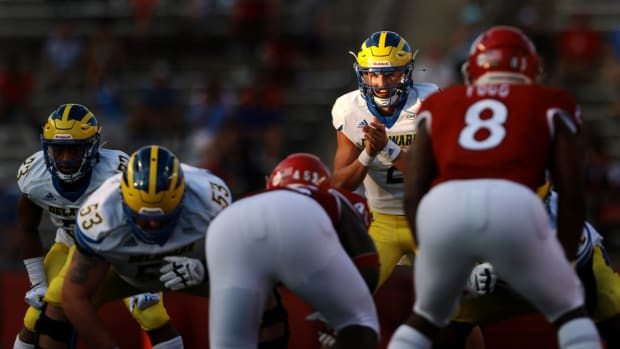 Sep 18, 2021; Piscataway, New Jersey, USA; Delaware Fightin Blue Hens quarterback Nolan Henderson (2) prepares for the snap in front of Rutgers Scarlet Knights linebacker Tyshon Fogg (8) during the second half at SHI Stadium. Mandatory Credit: Vincent Carchietta-USA TODAY Sports
