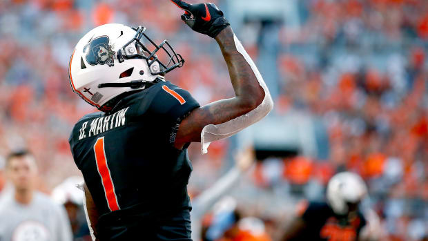 Sep 25, 2021; Stillwater, Oklahoma, USA; Oklahoma State Cowboys wide receiver Tay Martin (1) celebrates after catching a touchdown pass against the Kansas State Wildcats in the second quarter at Boone Pickens Stadium.
